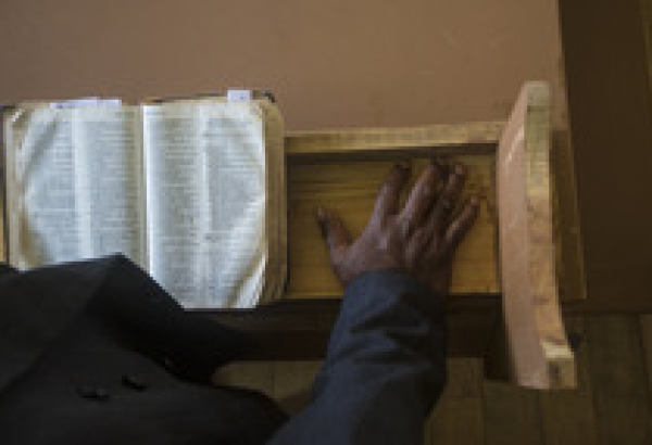 lightstock-63243-preacher-at-the-pulpit-with-an-open-bible
